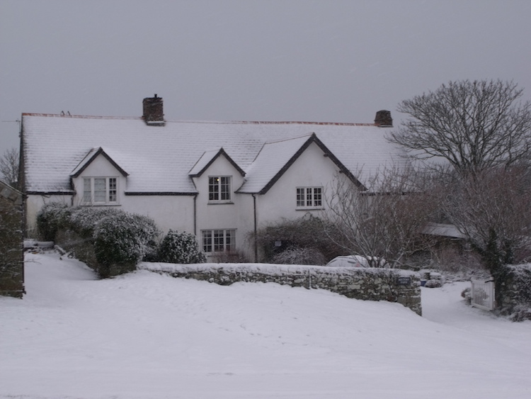 The front of The Recotry Tearooms covered in Snow